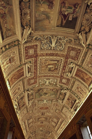 Ornate carved ceiling in the Vatican museum map room, Rome