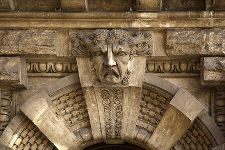 ornately: Ornately carved stone doorway with gargoyle, Rome