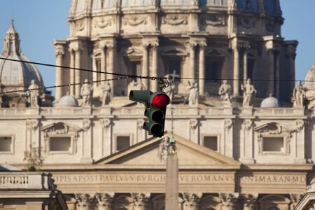 Red traffic light on the approach to St Peters, Rome photo