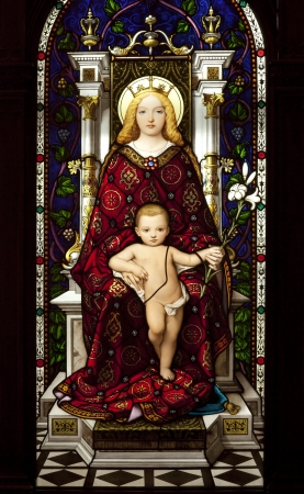 Stained glass window depicting madonna and child