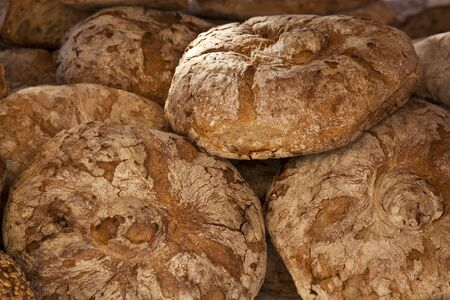Rustic bread loaves on a market stall, Majorca photo