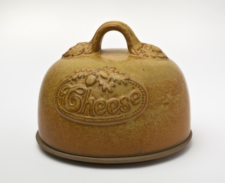 stoneware: Covered stoneware cheese dish with embossed decoration