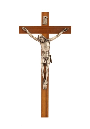 Crucifix with figure of Jesus on white background, vertical photo