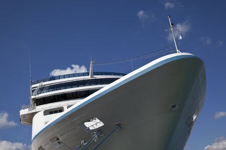 Cruise ship in port against blue sky photo