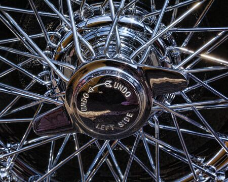 hubcap: Close up of wire wheel of sports car
