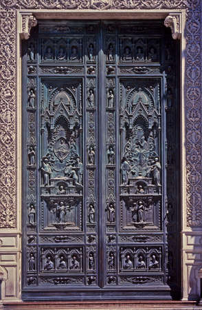 ornately: Ornately carved wooden doors Stock Photo