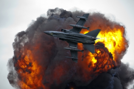 Jet fighter bomber in flight with explosion blast