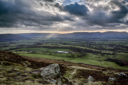 moors: Cockayne Ridge in the Cleveland Hills, North York Moors, England, with sun shining through clouds Stock Photo