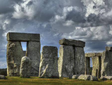 Close up of Stonehenge sunlit with dramatic clouds photo