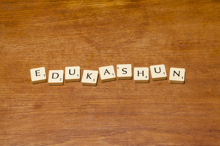 purposely: Game letter tiles purposely mis-spelling edukashun