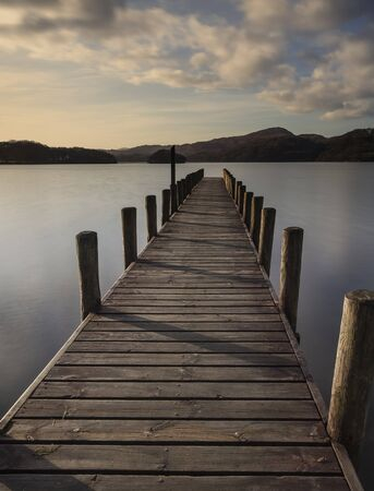cumbria: Jetty on Coniston Water, Lake District, Cumbria, at dusk