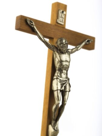 theology: Wooden crucifix with effigy of Christ closeup with glow effect vertical format