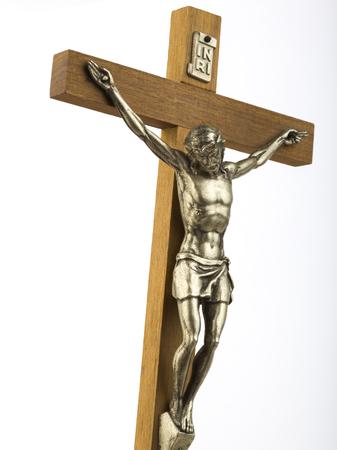 salvation: Wooden crucifix with effigy of Christ closeup vertical format