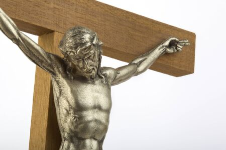 effigy: Wooden crucifix with effigy of Christ closeup horizontal format