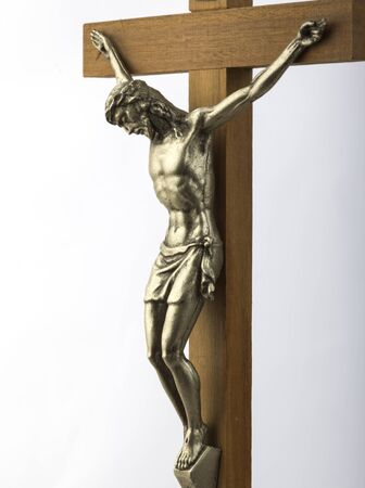 theology: Wooden crucifix with effigy of Christ closeup vertical format