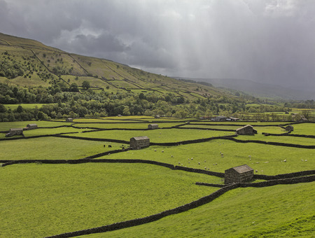 north yorkshire: Rainstorm passing down the valley at Gunnerside, Swaledale, North Yorkshire