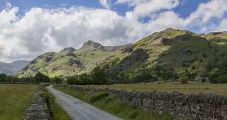 langdale pikes: Panorama of the Langdale Pikes from a country lane