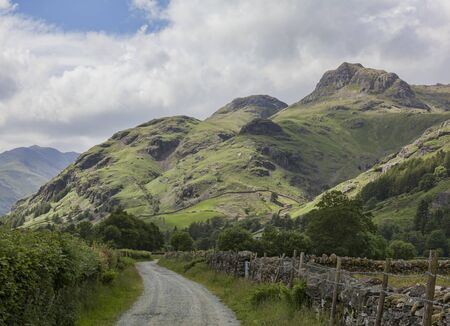 langdale pikes: The Langdale Pikes from a country lane