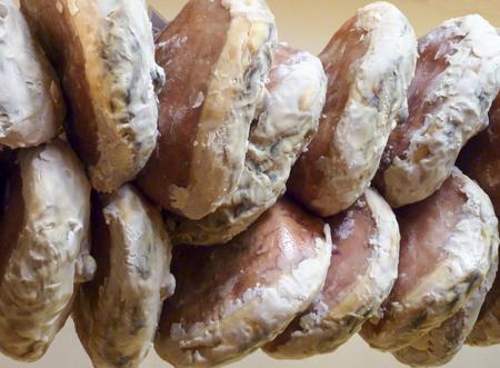 cured ham: Cured ham legs on display in Italian delicatessen, close up Stock Photo