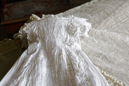baptismal: Antique lace Christening gown laid out on a bed Stock Photo