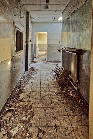 urban decay: Abandoned workshop corridor, urban exploration, hdr