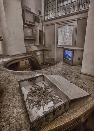 dilapidation: Abandoned high school reception desk, urban exploration, hdr