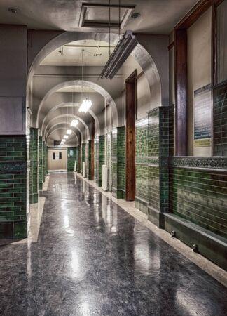 urban decay: Abandoned high school corridor, urban exploration, hdr