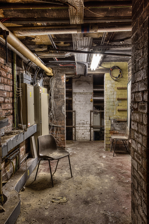 urban decay: Abandoned workshop utility room, urban exploration, hdr