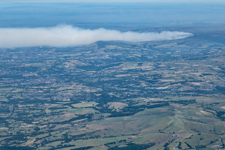 Aerial view of column of smoke from wild fire on Saddleworth Moor Lancashire England