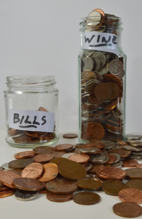 pennie: Coins Saved in Jars for Bills and Wine
