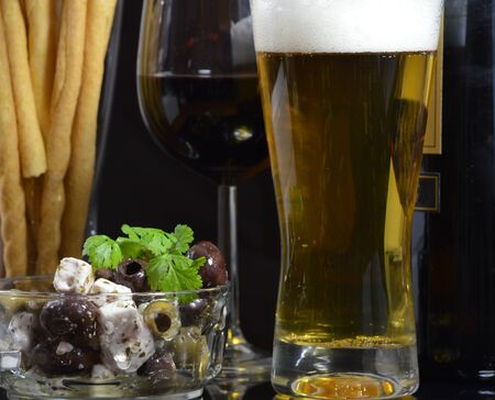Bowl of Olives , Beer and Red Wine photo
