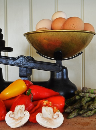 vegtables: Old Fashioned Scales with Eggs and Vegtables Stock Photo