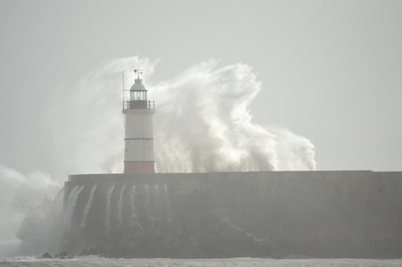 lighthouse at Newhaven Harbour, East Sussex, UK photo