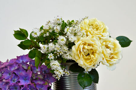 A Niave Flower display in a can photo