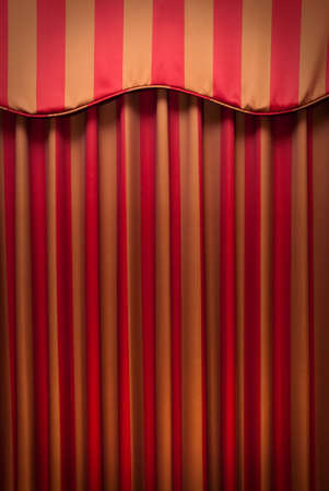 background texture: Red and gold striped fabric curtains. Stock Photo