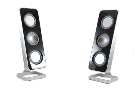 Two black and silver modern speakers tilted towards each other on a white isolated background photo