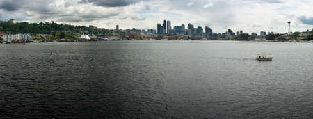 The Seattle skyline white white clouds and shoreline of Lake Union photo