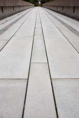 Clean cut stone pavers in a long pattern down a walkway. photo
