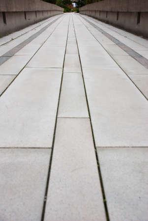 cut: Clean cut stone pavers in a long pattern down a walkway.