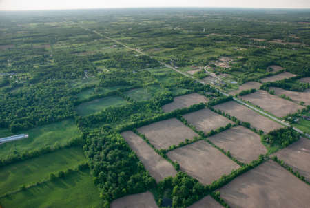Aerial view of a grean rural area under a long horizon. photo
