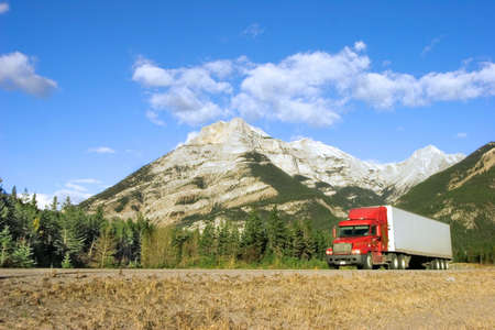 18 wheeler: a red truck goes through the canadian rockies