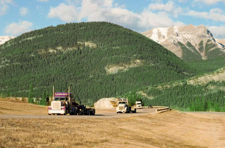 numberplate: three trucks coming up the Canadian Rockies