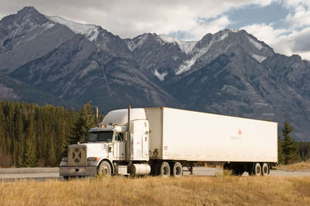 18 wheeler: a truck stops in a rest area in the Canadian Rockies