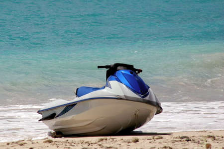 buoyancy: a jet ski on the beach Stock Photo