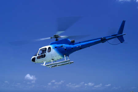 barbados: a helicopter taking off in Barbados