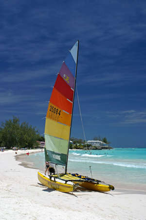 catamaran: a catamaran on the beach in Barbados Stock Photo