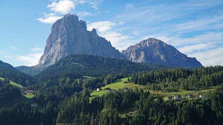 Beautiful view to the most distinctive mountains in the Gardena Valley: Sassolungo and Sassopiatto / Lanngkofel and Plattkofel / Dolomites / South Tyrol / Italy