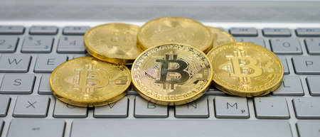 Close Up of Bitcoins on a keyboard - Future Currency - finance concept -