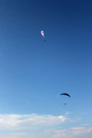 Awesome paragliding moment: Paragliding concept / Paraglider flying in beautiful Natural mountain landscape in Austria / Hohe Wand / Schneeberg