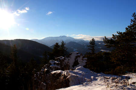 Perfect winter hiking day: Beautiful view from vista Point Kleine Kanzel at Hohe Wand Mountain in Lower Austria
